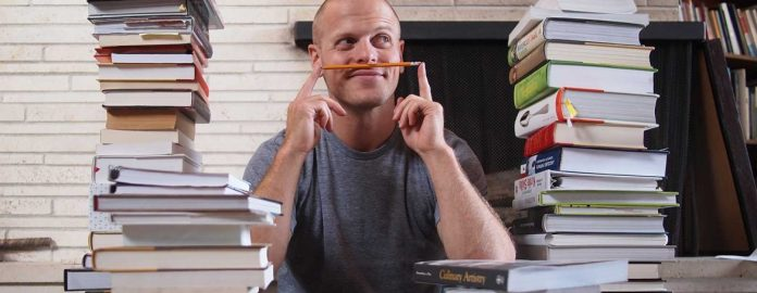 Tim-Ferriss-with-Books-1-1170x455